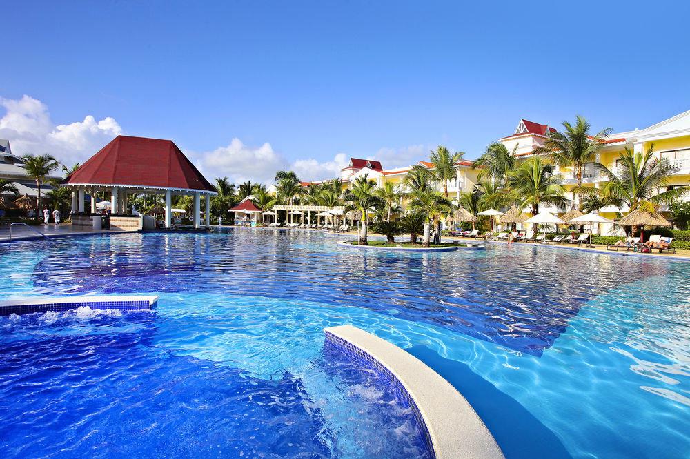 water sky umbrella Pool swimming pool swimming aquatic mammal leisure Resort mammal blue resort town dolphin Water park day
