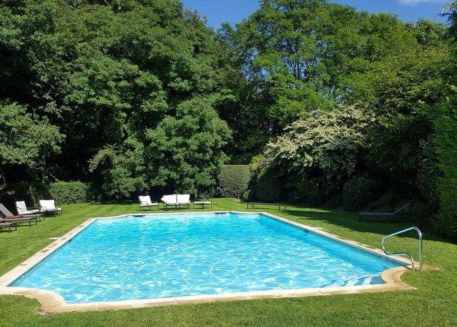 tree grass swimming pool property leisure Pool Sport backyard lawn Villa blue swimming