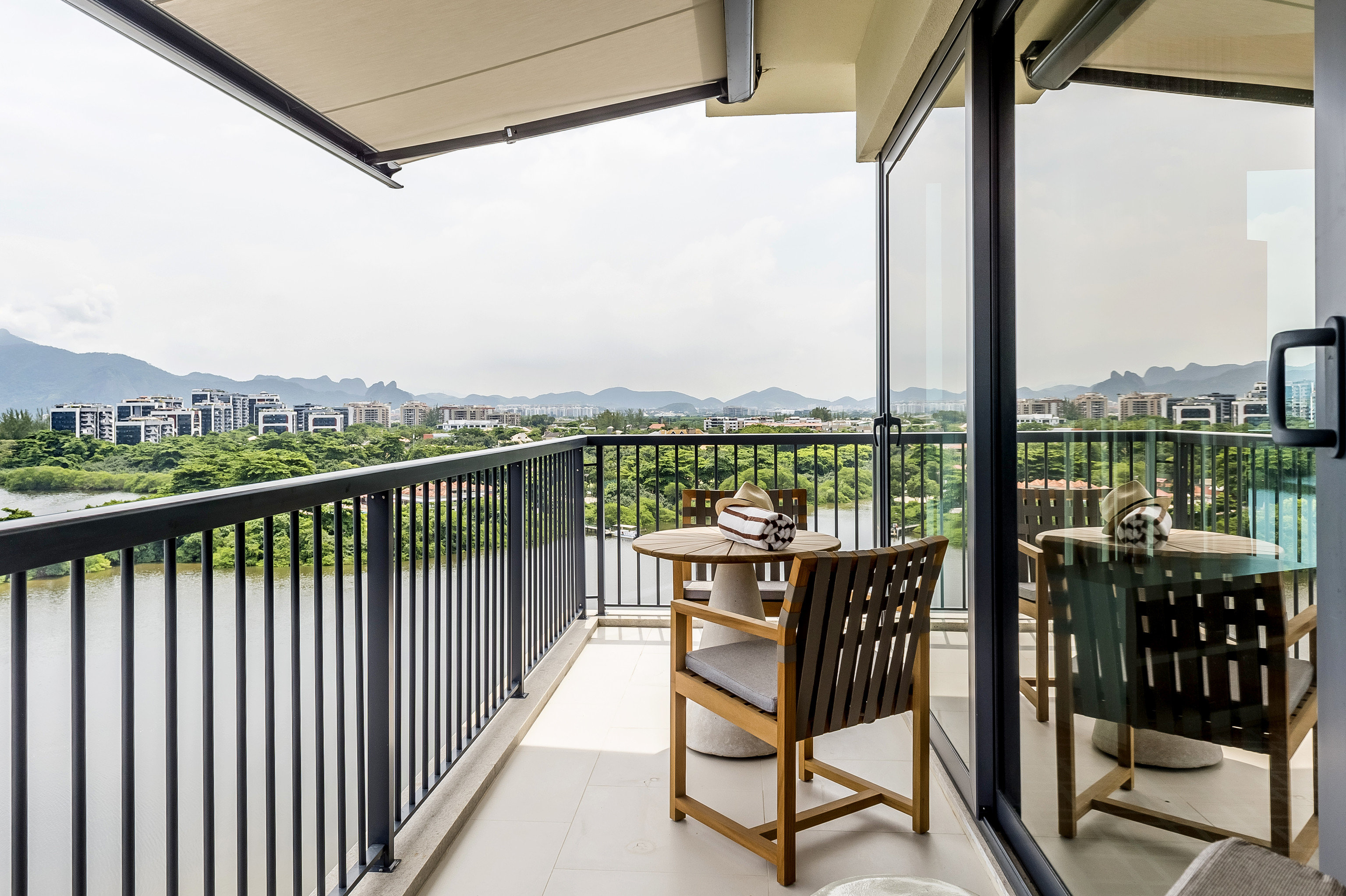 Hotels sky chair building outdoor property porch Balcony real estate Deck apartment home outdoor structure window house estate roof overlooking condominium area furniture