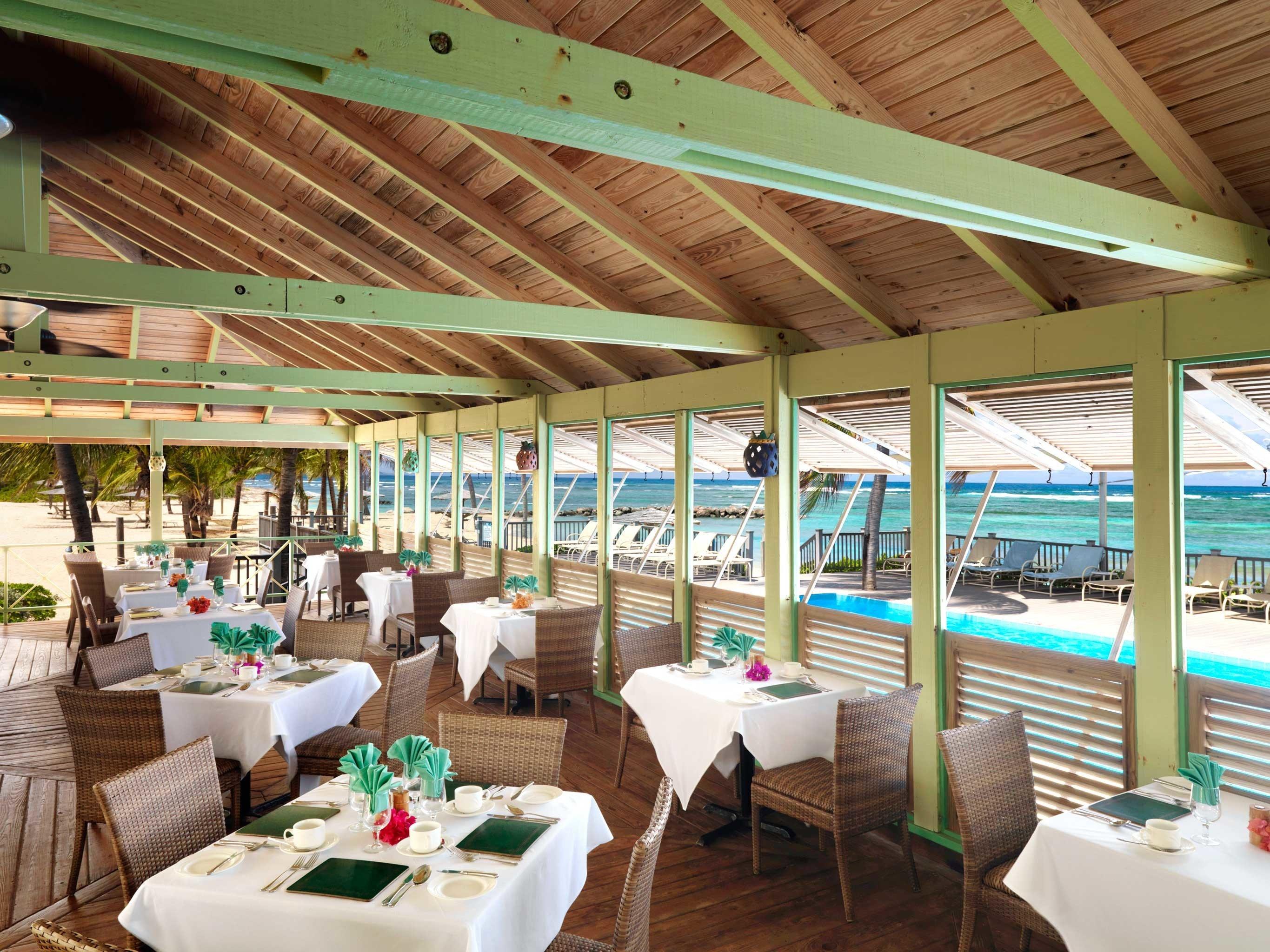 Bar Beach Beachfront Dining Drink Eat Islands Luxury Luxury Travel Scenic views Trip Ideas ceiling indoor restaurant Resort estate interior design furniture area