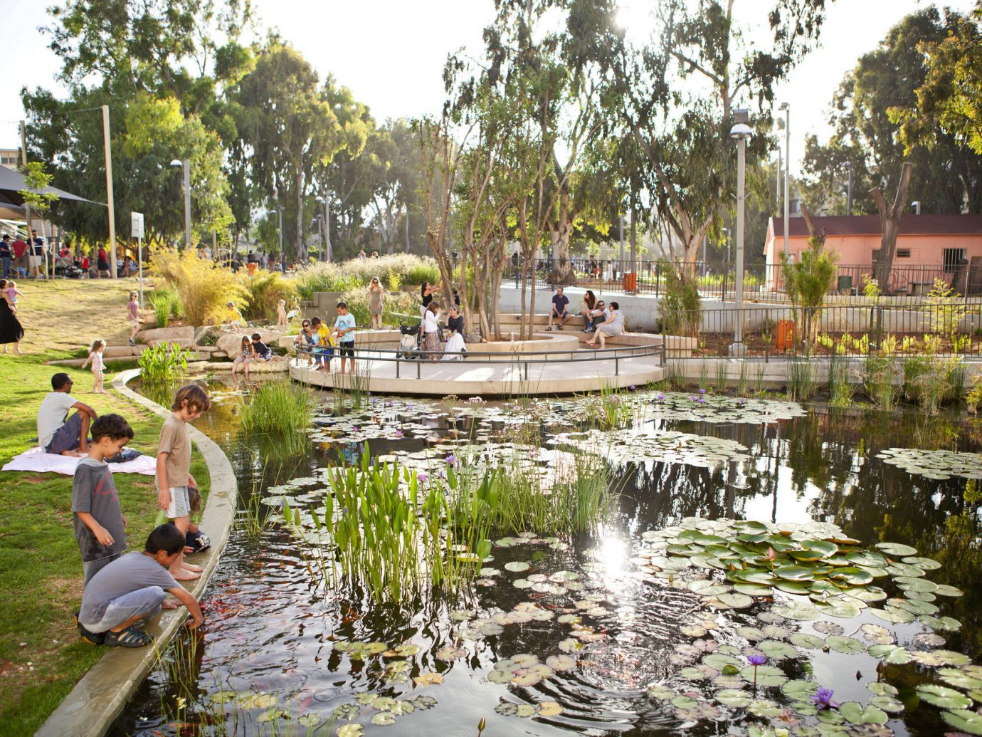 Family activities Outdoor Activities Parks pond tree outdoor sky grass Nature Garden water water feature fountain plaza botanical garden park town square backyard Resort