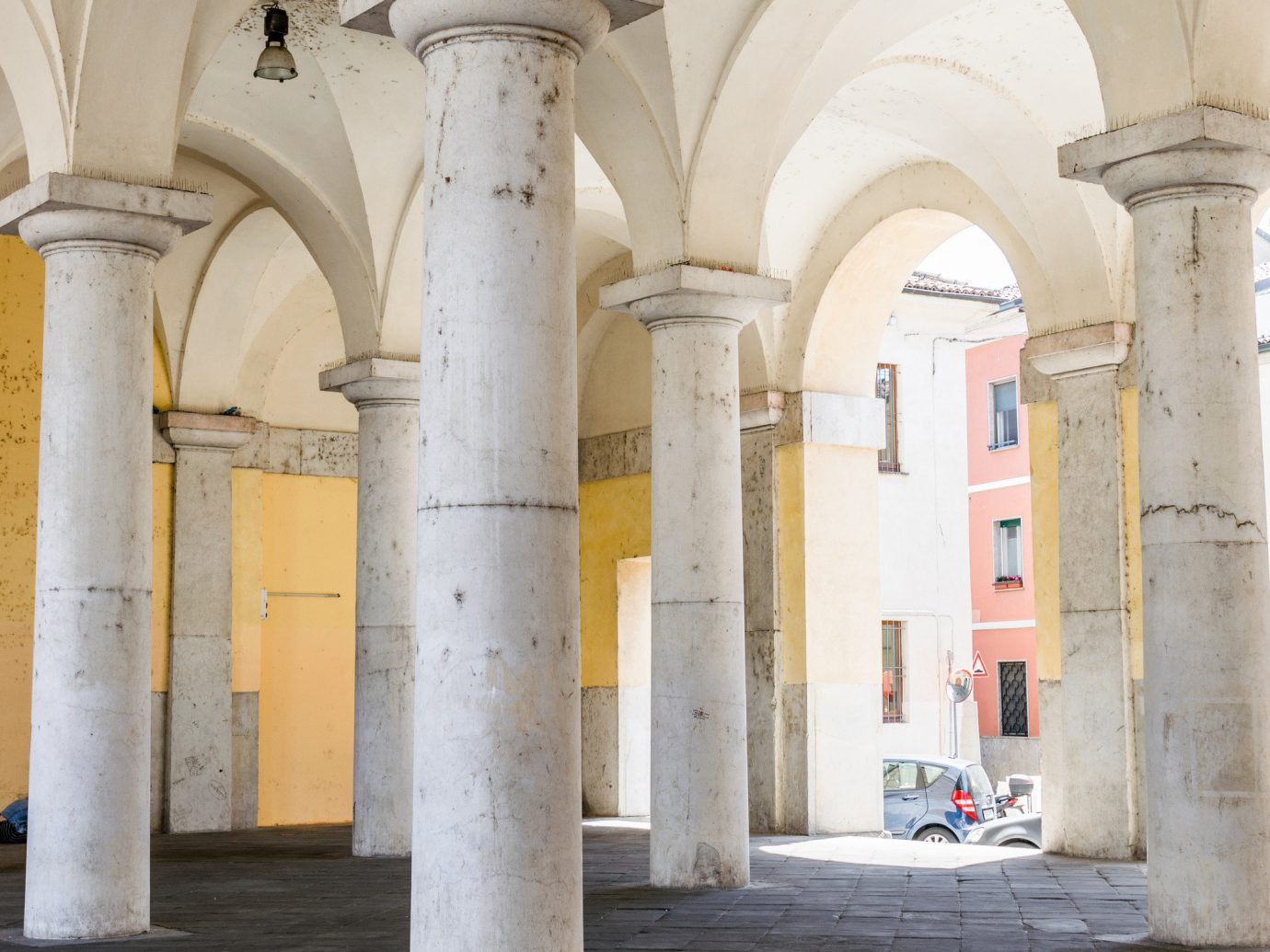 Arts + Culture Italy Milan Trip Ideas arch column arcade structure historic site building abbey history ancient history place of worship vault crypt medieval architecture daylighting