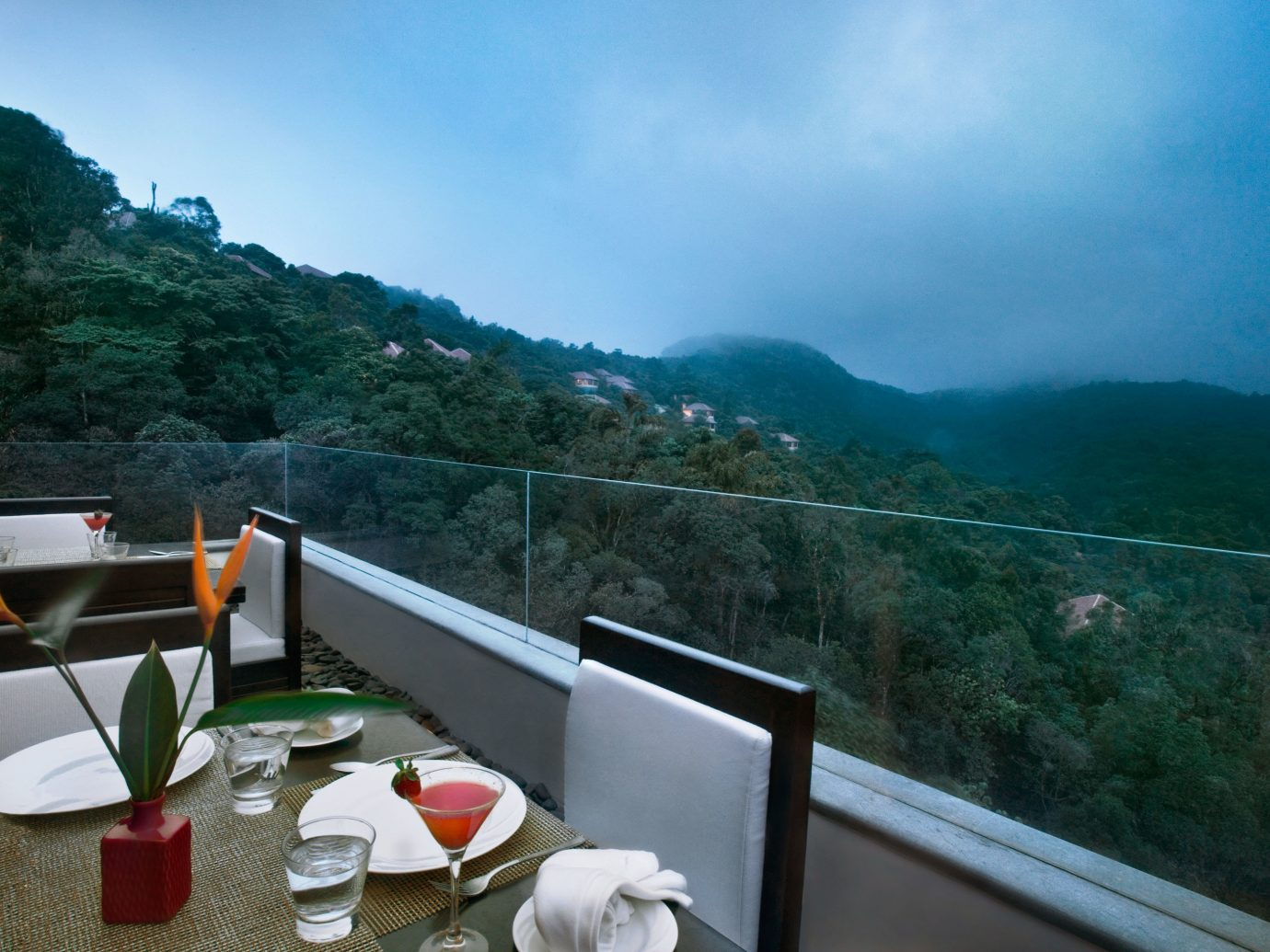 Balcony Dining Drink Eat Elegant Forest Hotels Luxury Patio Scenic views Terrace outdoor mountain vacation tourism travel Sea mountain range