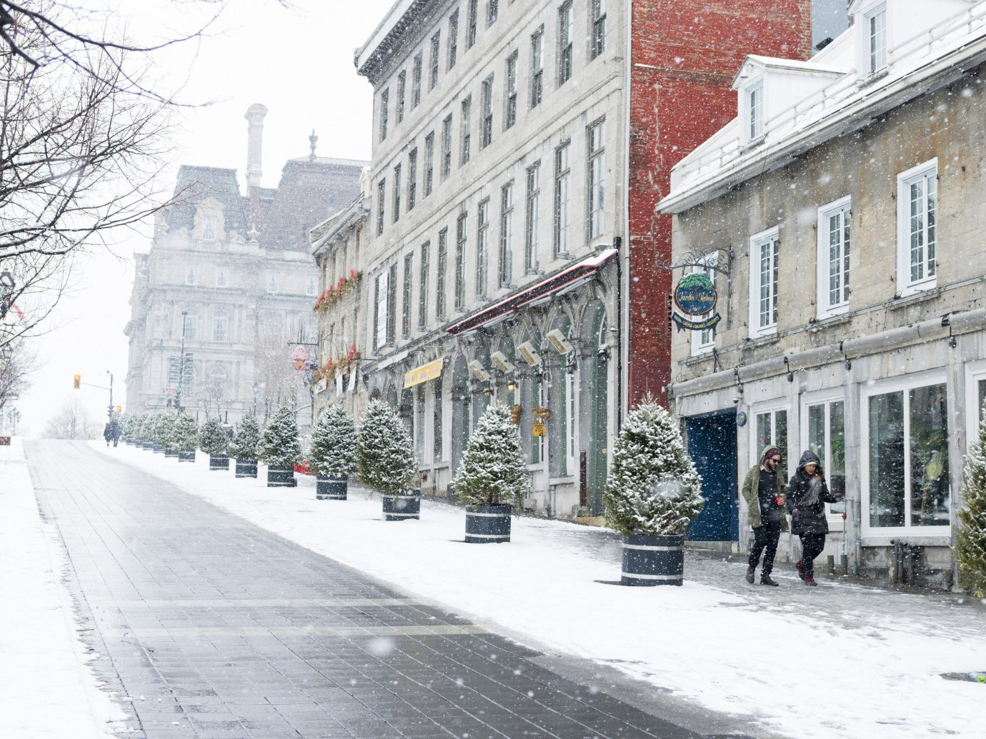 Trip Ideas Weekend Getaways outdoor building way snow Winter scene Town neighbourhood sidewalk street urban area City tree freezing lane road Downtown house facade blizzard tours day