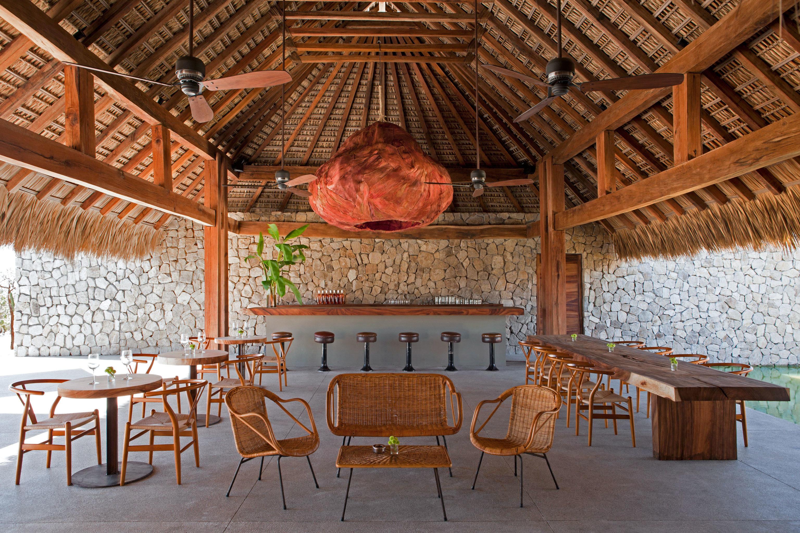 Bar Drink Eat Hotels Scenic views chair floor room property estate wood restaurant cottage interior design farmhouse log cabin barn