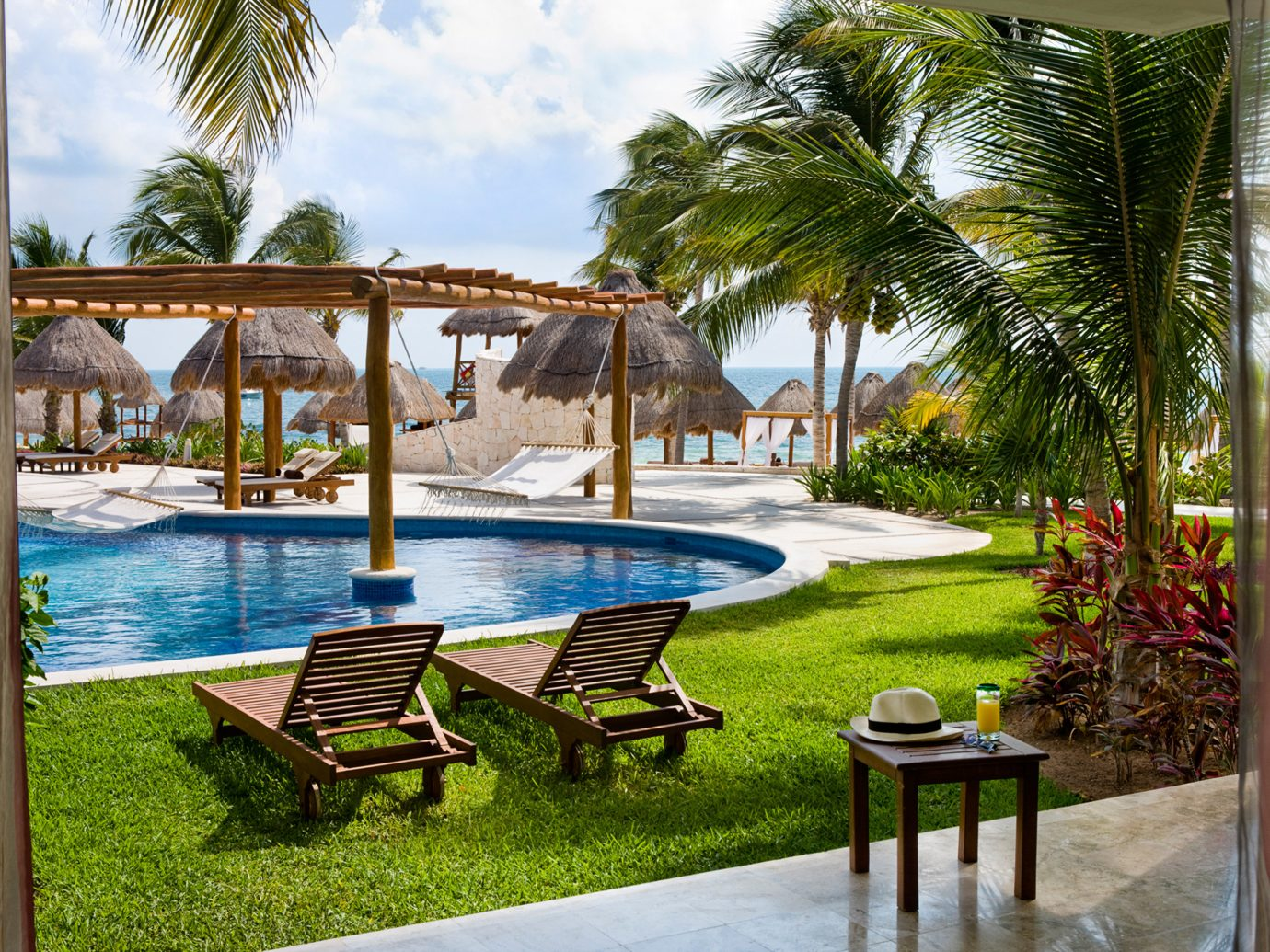 All-Inclusive Resorts Hotels Living Lounge Luxury Pool Romance Tropical outdoor tree grass chair leisure property Resort estate vacation swimming pool lawn home Villa backyard real estate hacienda caribbean area plant palm furniture