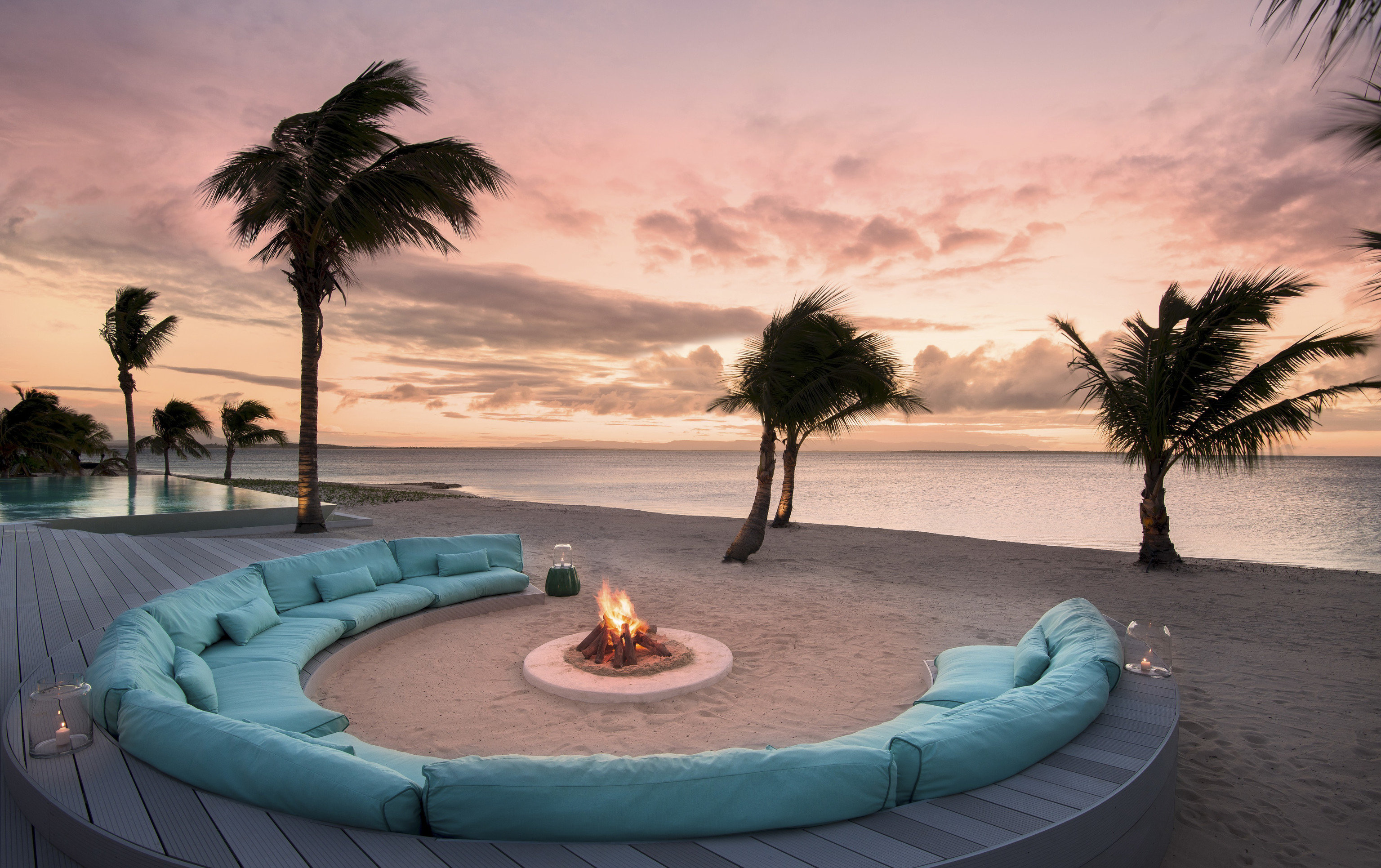 Boutique Hotels Hotels Luxury Travel water sky palm tree arecales tree Sea Sunset plant vacation reflection evening sunrise landscape tropics cloud palm horizon swimming pool outdoor object
