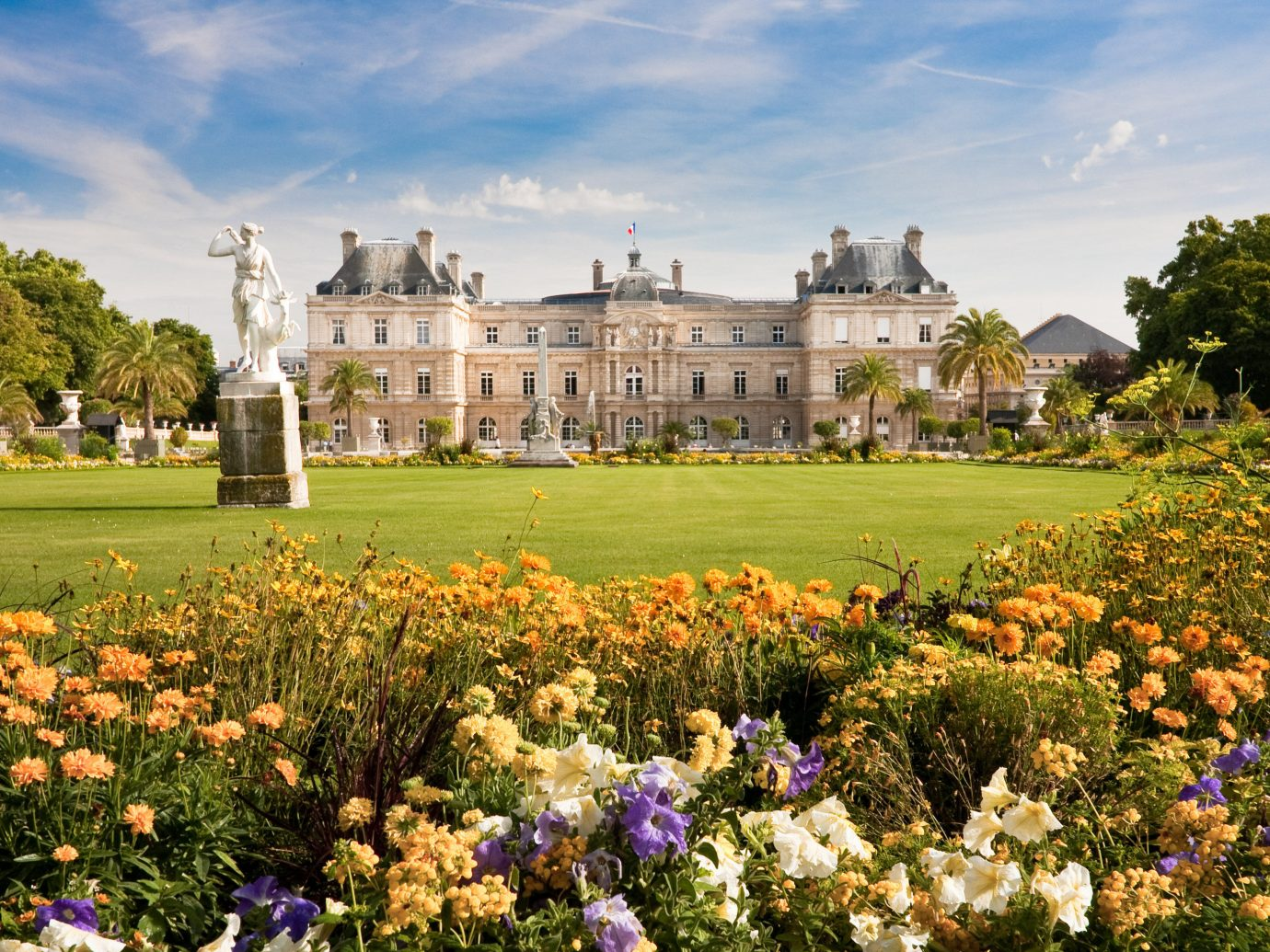 France Hotels Paris Trip Ideas flower grass outdoor tree sky château Garden estate tourism park rural area lawn autumn palace castle plant surrounded pretty field crowd
