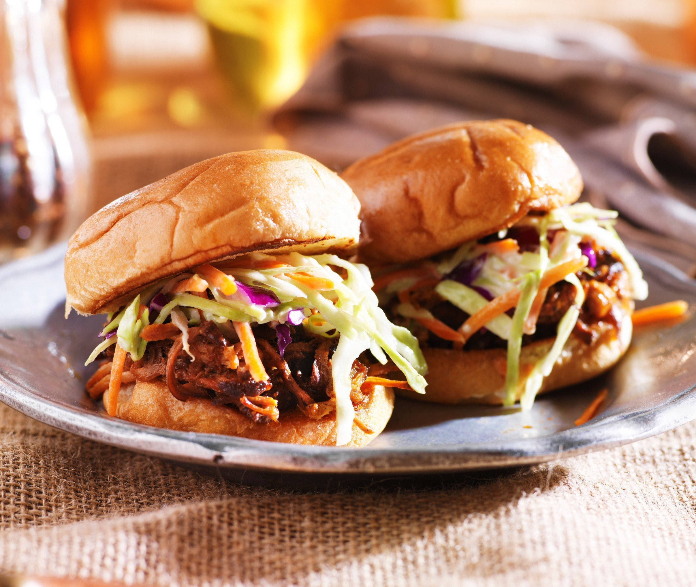 Food + Drink food dish plate sandwich pulled pork meat slider cuisine sloppy joe cheeseburger meal hamburger breakfast produce cheesesteak snack food