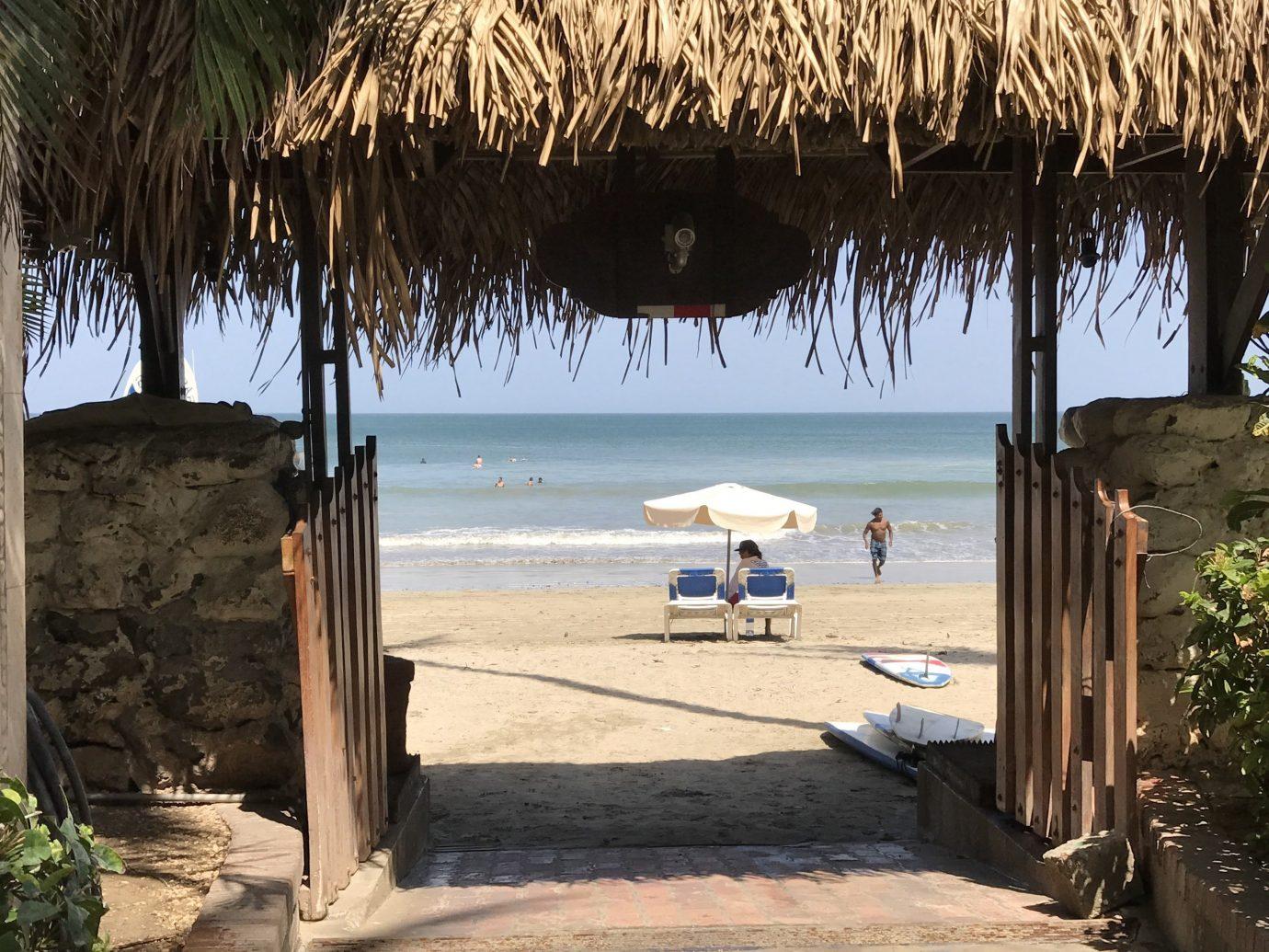 Health + Wellness Meditation Retreats Trip Ideas Yoga Retreats tree outdoor Beach ground water body of water plant palm Ocean Sea vacation sandy Coast bay shade shore day