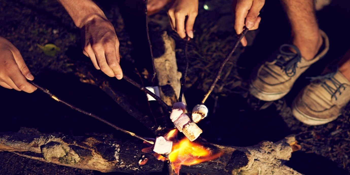 Outdoors + Adventure person cutting knife cut slice soil campfire chocolate