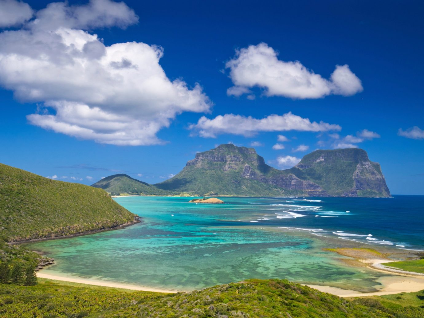 Travel Tips sky water outdoor Nature geographical feature landform blue Coast body of water Sea mountain horizon cloud Ocean bay Beach cape islet loch caribbean Island Lagoon terrain fjord cove promontory clouds overlooking shore day highland