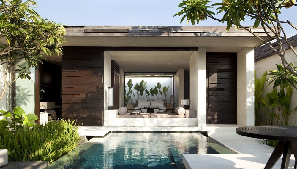 Travel Tips tree building plant Living property home estate swimming pool house Villa condominium real estate porch backyard Courtyard Resort facade interior design cottage mansion outdoor structure furniture