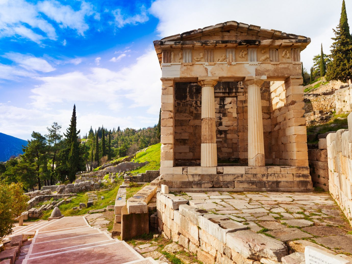 Arts + Culture Landmarks Trip Ideas sky outdoor historic site building archaeological site ancient history Ruins temple tourism tourist attraction history stone facade tree ancient greek temple estate ruin