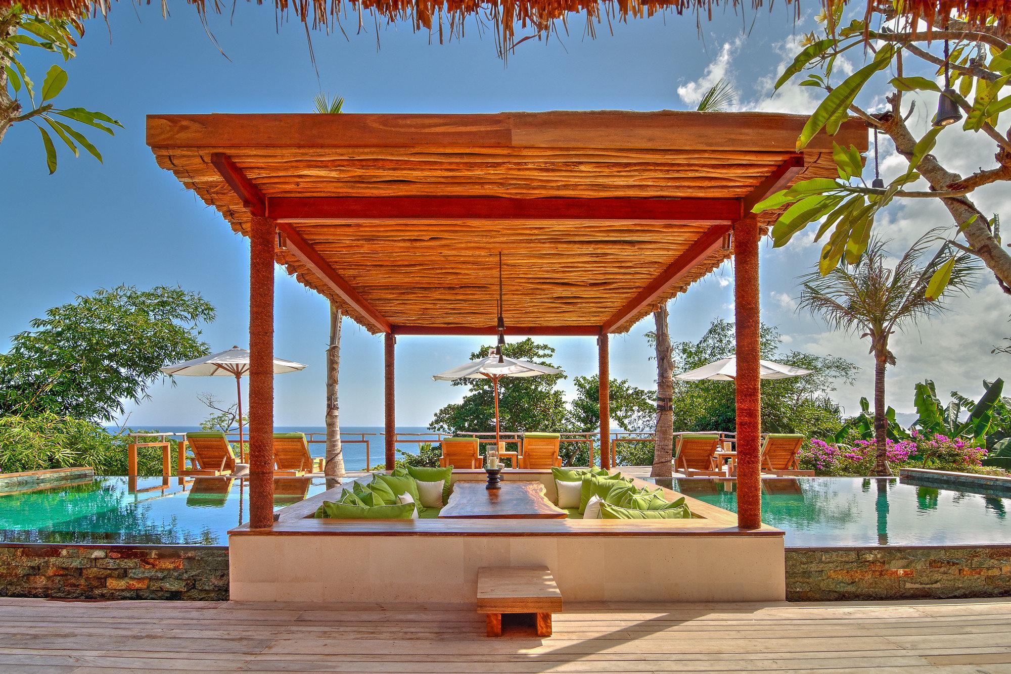 Beach Islands Luxury Travel Trip Ideas tree outdoor sky building pavilion estate outdoor structure shrine temple Resort furniture
