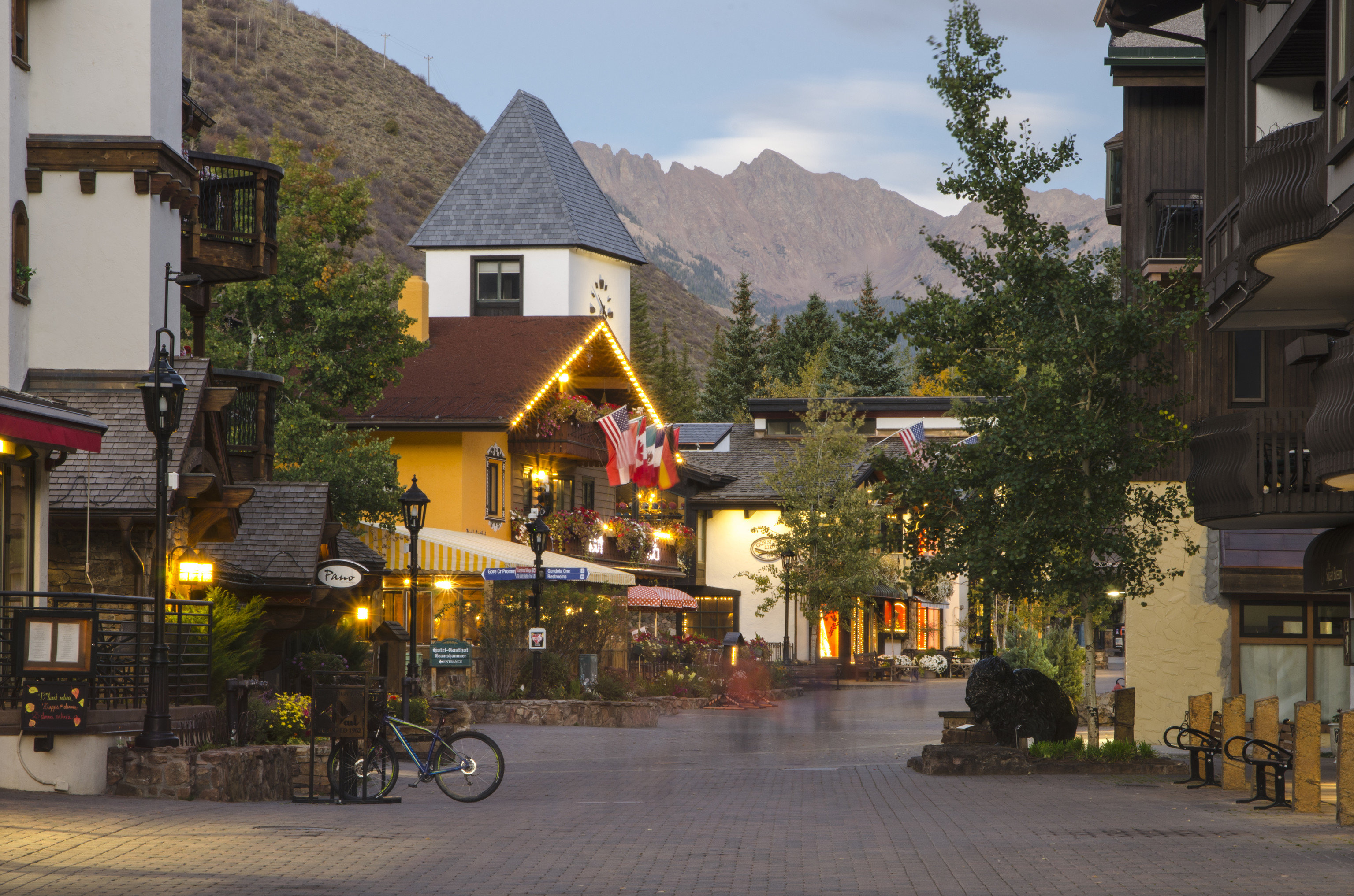 Mountains + Skiing Outdoors + Adventure building outdoor road Town house neighbourhood City way human settlement street vacation residential area Village tourism Downtown sidewalk travel restaurant