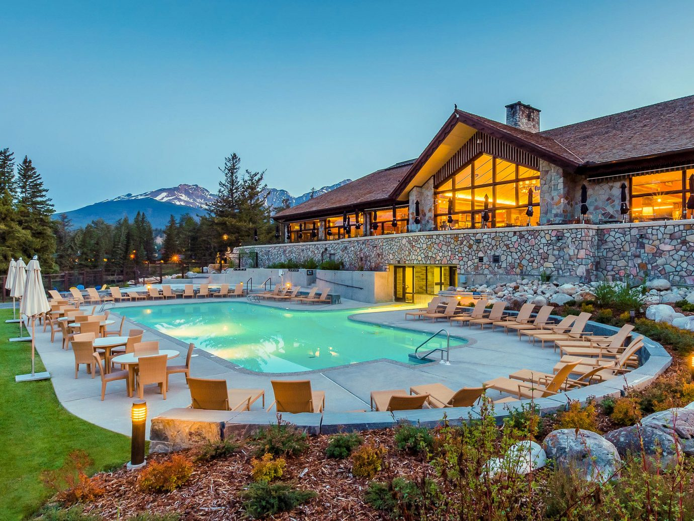 Alberta Boutique Hotels Canada Hotels Road Trips swimming pool property Resort leisure estate resort town water real estate home reflection Villa house sky landscape cottage vacation amenity