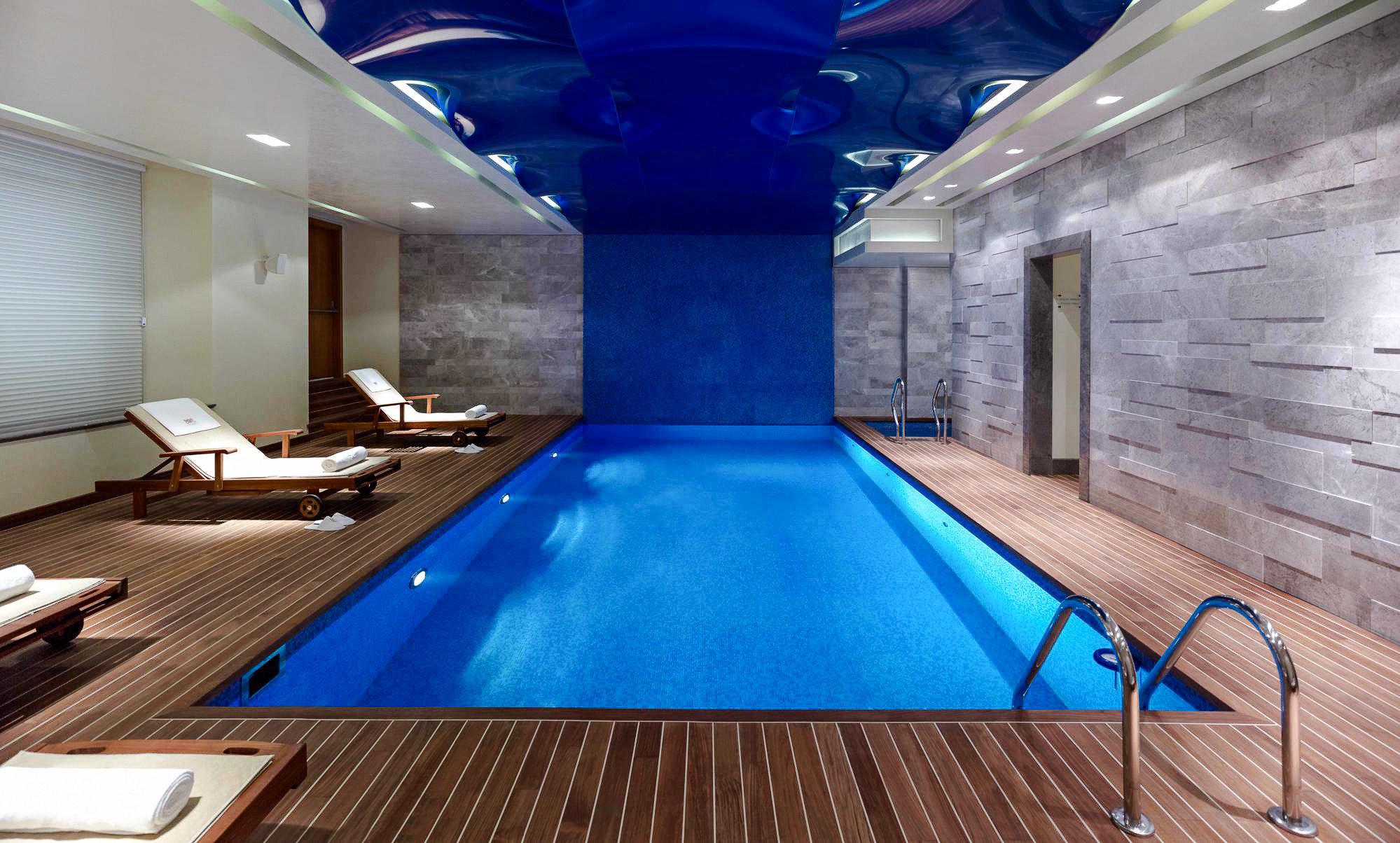 Boutique Hotels Hotels Luxury Travel swimming pool room interior design lighting floor leisure recreation room leisure centre flooring daylighting amenity ceiling estate blue