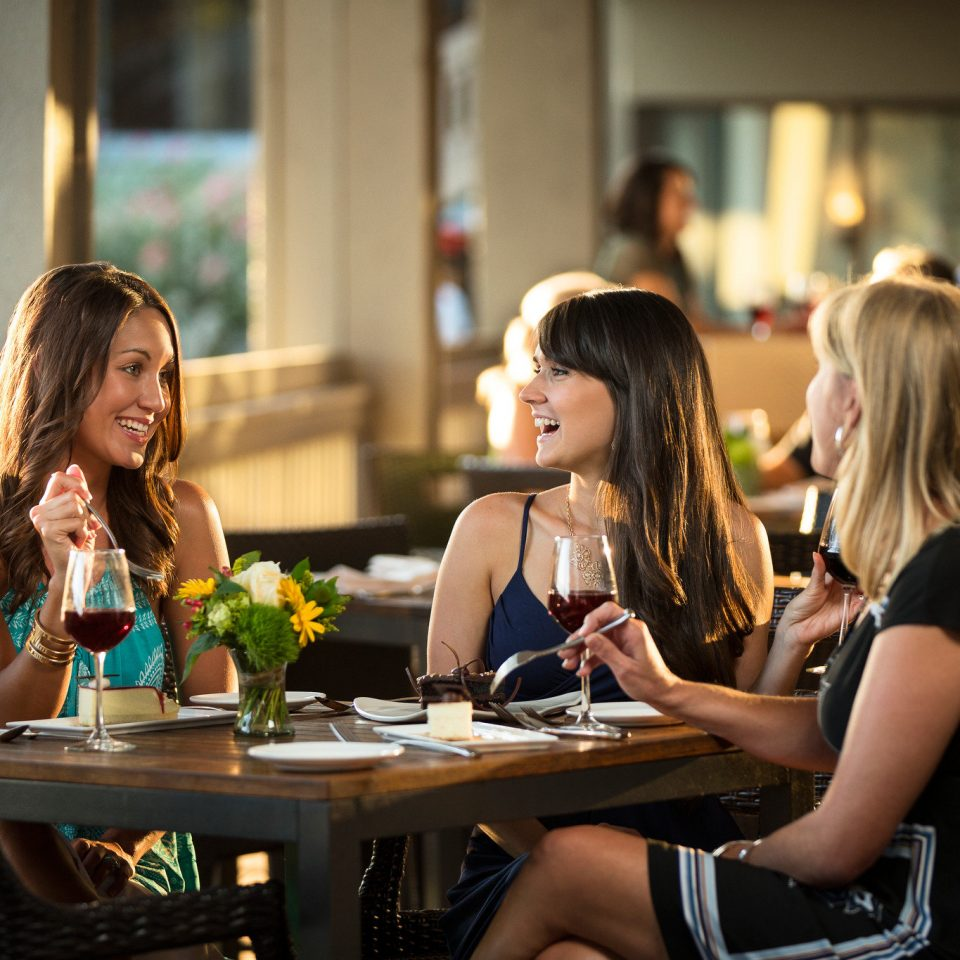 sitting woman rehearsal dinner restaurant
