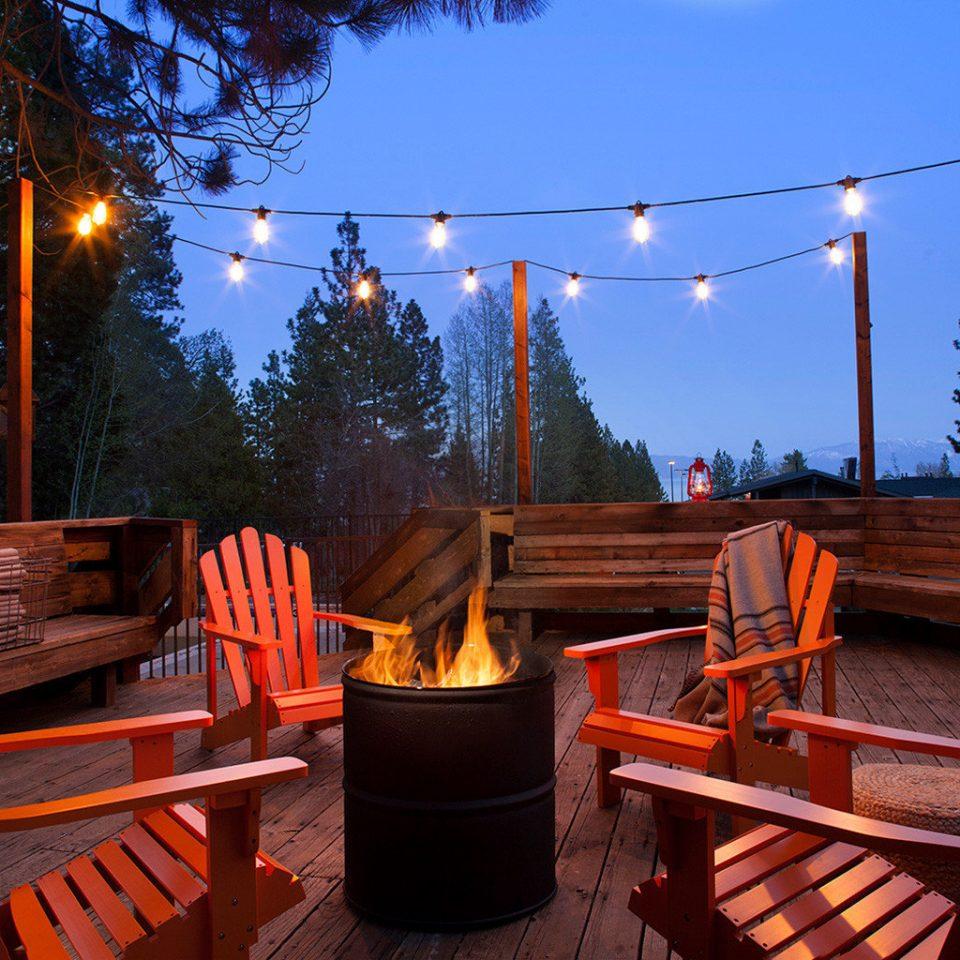 adirondack chairs dusk string lights tree sky chair man made object night evening lighting restaurant Resort outdoor structure