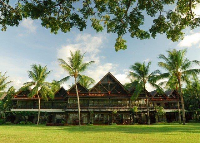 tree grass sky structure Resort sport venue arecales plant plantation caribbean lawn palm