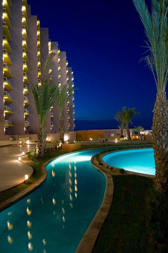 swimming pool night light Resort condominium arecales