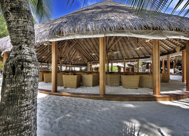 Resort gazebo outdoor structure hut pavilion arecales hacienda palm tree day