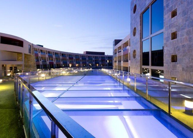 sky building swimming pool leisure property leisure centre sport venue Resort train ice rink platform arena plaza convention center