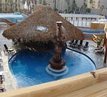 swimming pool art wooden sculpture water feature blue Resort
