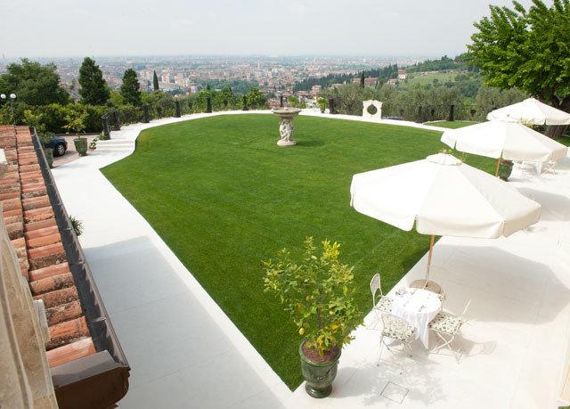 grass sky structure sport venue landscape architect lawn swimming pool backyard Resort