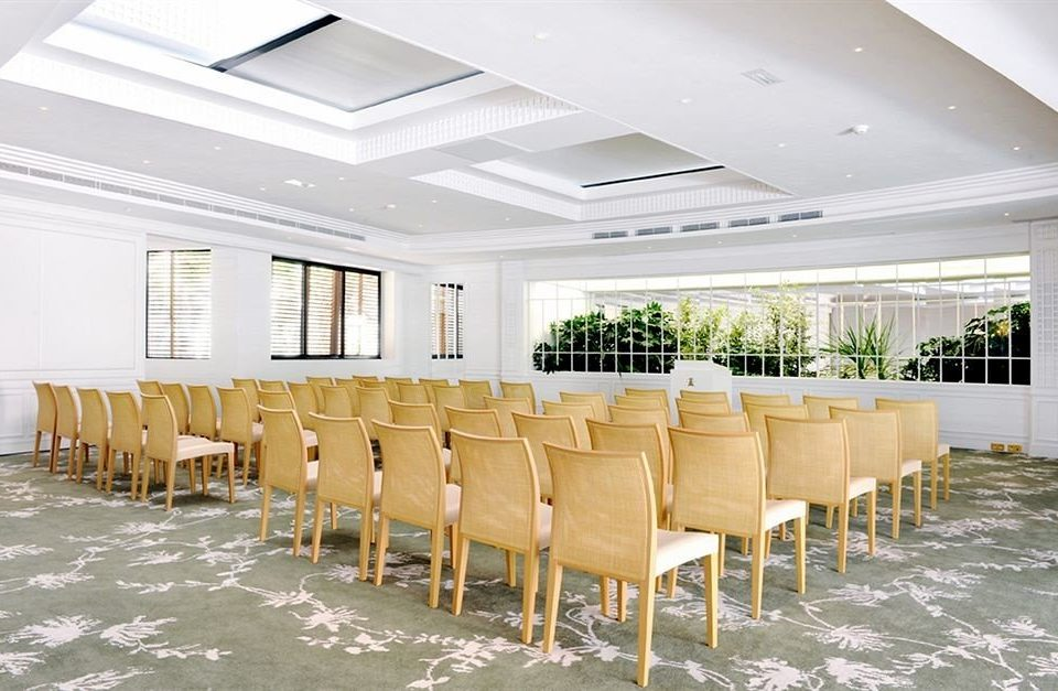 chair property function hall conference hall convention center row restaurant Resort ballroom condominium lined line conference room