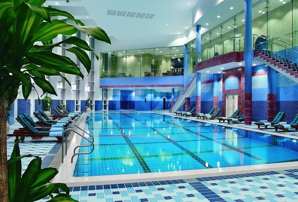 swimming pool leisure Resort leisure centre condominium blue plant swimming