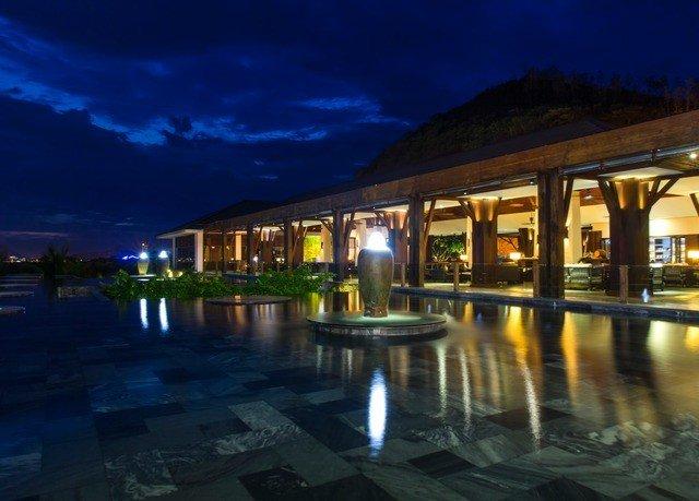 Resort night swimming pool evening bridge marina mansion