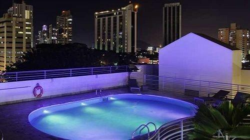 swimming pool building condominium Resort landscape lighting night car
