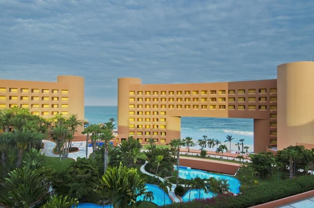 Resort leisure property condominium building plaza convention center headquarters swimming pool shopping mall colonnade