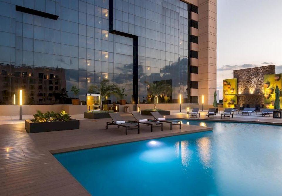 swimming pool property plaza condominium building reflecting pool lighting convention center headquarters Resort