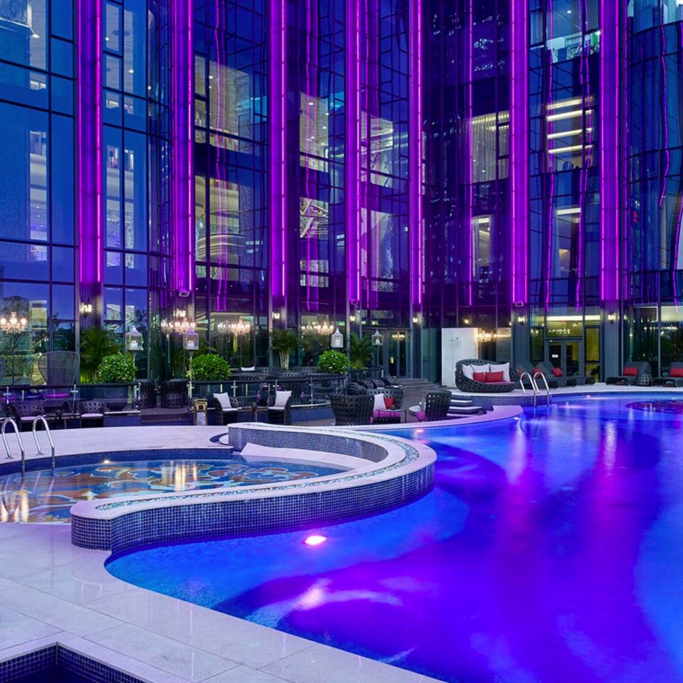 purple building swimming pool leisure condominium plaza convention center Resort
