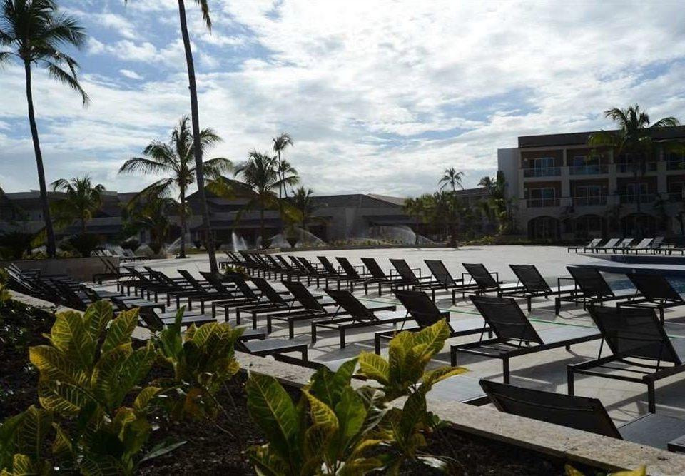 sky tree property structure building plaza Resort sport venue condominium lawn marina stadium lined shade