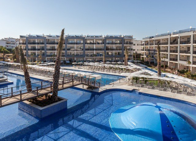 sky building swimming pool property condominium Resort leisure centre marina plaza