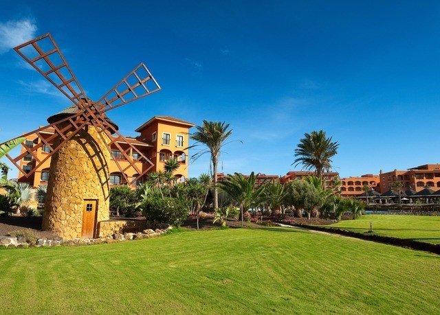 grass sky structure property building outdoor object windmill sport venue Resort mill