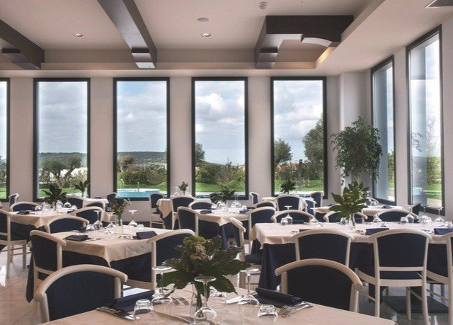 chair property restaurant conference hall function hall condominium convention center Resort meeting dining table