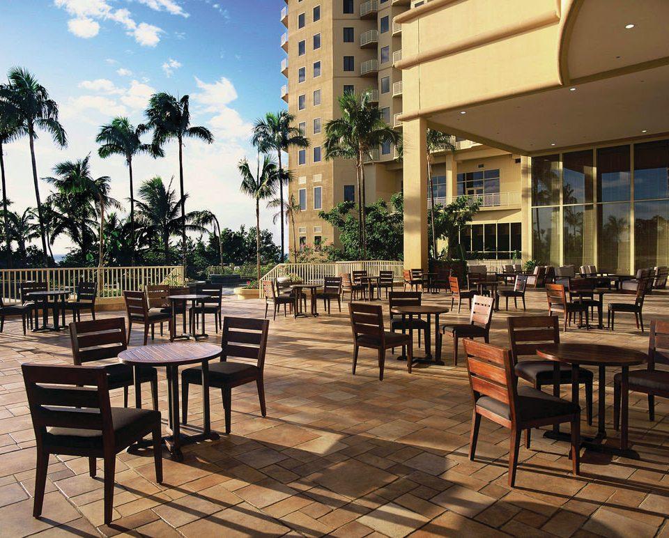 chair property plaza condominium Resort restaurant walkway outdoor structure set