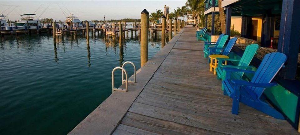 water ground wooden chair dock pier vehicle Resort waterway lined