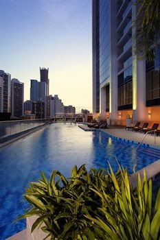 condominium swimming pool plant reflecting pool Resort skyscraper cityscape marina