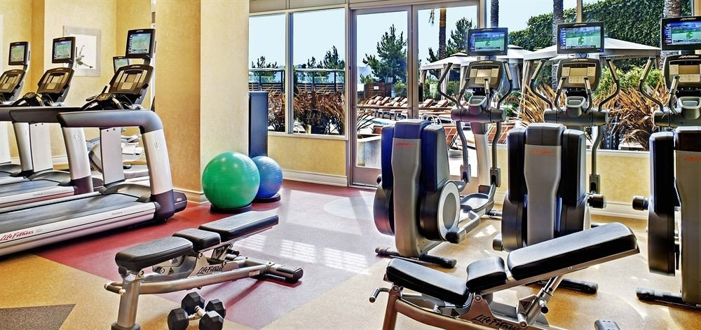 structure gym sport venue desk office physical fitness Resort condominium cluttered