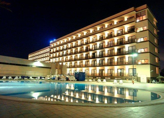 condominium swimming pool plaza leisure centre night lighting convention center Resort headquarters
