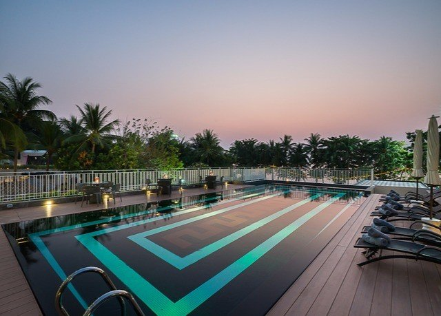 sky ground swimming pool property condominium Resort walkway lined