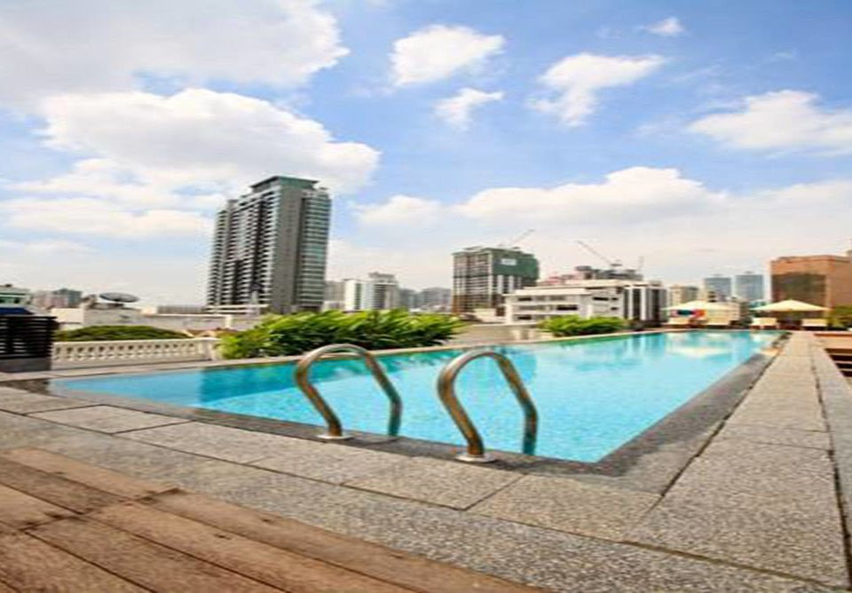 sky ground swimming pool condominium property walkway reflecting pool Resort plaza shore