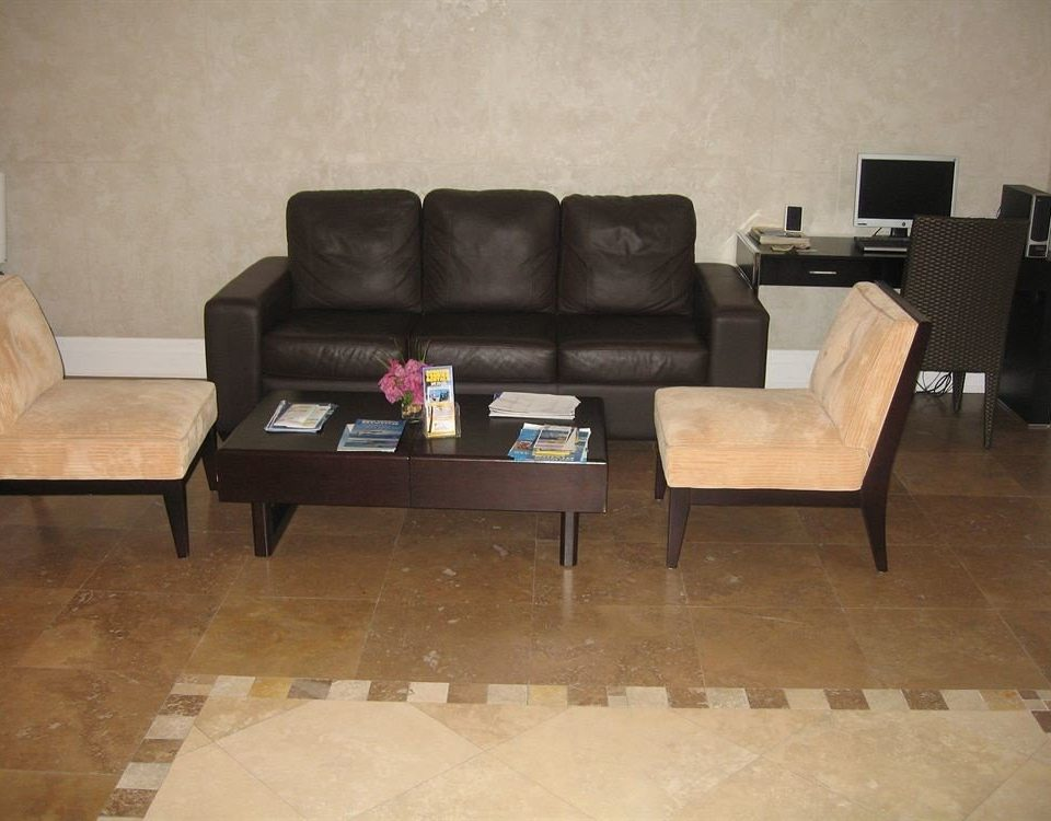 Resort property living room hardwood flooring couch seat wood flooring sofa leather
