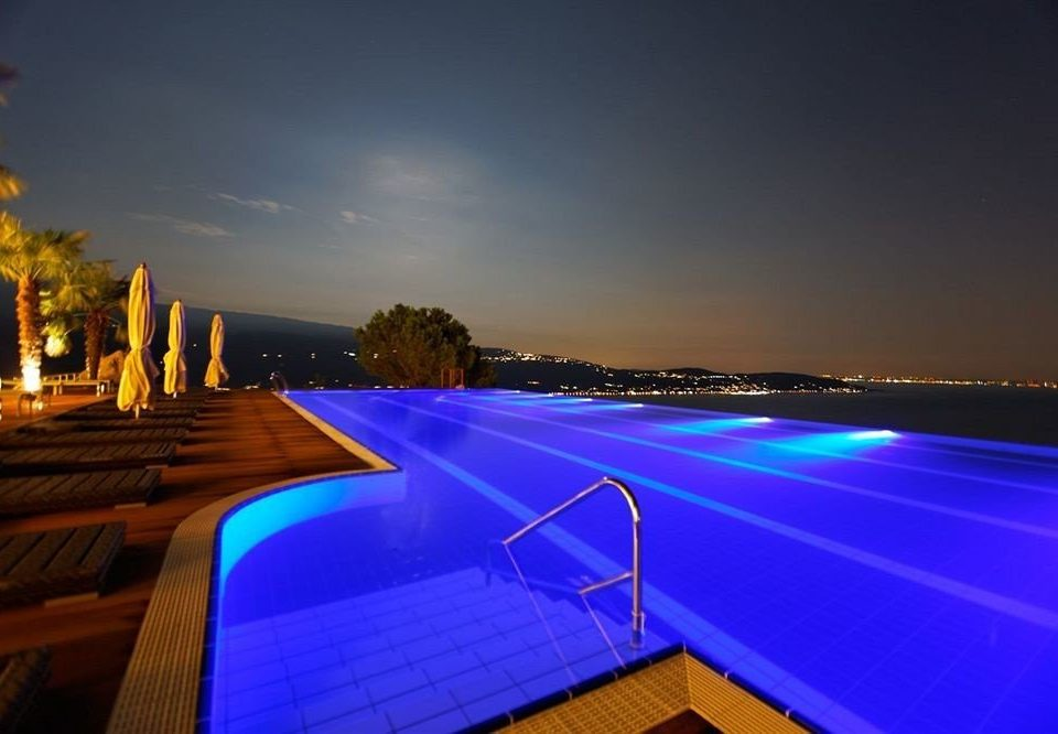 sky structure swimming pool night light horizon evening dusk lighting Resort